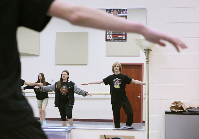Tyler Owen, from right, and Makenna Bear dance and are reflected in a mirror during Chris Harperճ tap class at Faith Lutheran Middle School and High School Wednesday, Feb. 10, 2016, in Las V ...