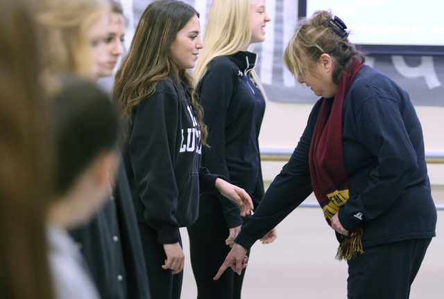 Chris Harper, right, gives instruction to studnets during tap class at Faith Lutheran Middle School and High School Wednesday, Feb. 10, 2016, in Las Vegas. The performing arts school offers a rang ...