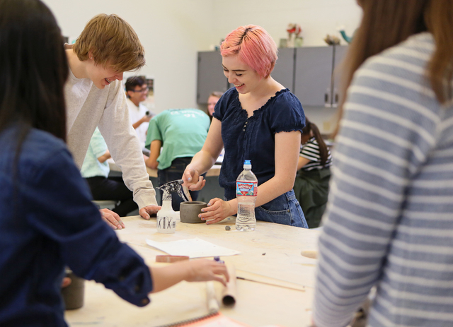 Samuel Teigen, 16, center left, and Scout Siu, 17, center right, work together in Sierra Slentz's ceramics and 3D design class at Las Vegas Academy of the Arts Thursday, Feb. 11, 2016, in Las Vega ...