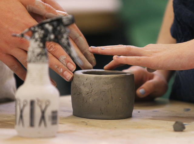 Samuel Teigen, 16, left, and Scout Siu, 17, work together in Sierra Slentz's ceramics and 3D design class at Las Vegas Academy of the Arts Thursday, Feb. 11, 2016, in Las Vegas. Ronda Churchill/La ...