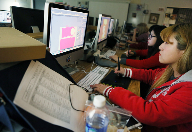 Cho Yi, 18, right, and JJ Lee, work on projects in Ashley Stroud's digital arts lab at Las Vegas Academy of the Arts Thursday, Feb. 11, 2016, in Las Vegas. Ronda Churchill/Las Vegas Review-Journal