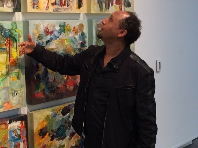 "Eyob Mergia talks about his art Feb. 8 at the Sahara West Library, where he had dozens of works on display. His exhibit, ""The Philosophy of Form and Color,"" is on display there through April 2 ..."