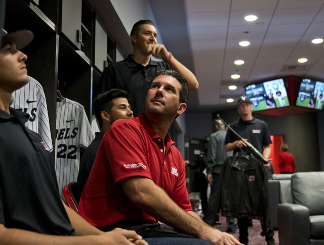 President of the M Resort Anthony Marnell III, center, tours the new Anthony and Lyndy Marnell III Baseball Clubhouse during a ribbon cutting ceremony on the UNLV campus on Monday, March 7, 2016.  ...