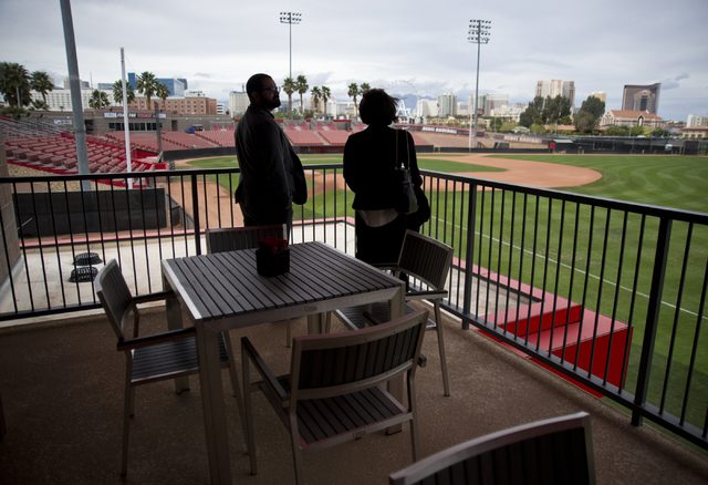 Marian Alper, right, and Jorge Labrador take in the view from a balcony on the second floor of the new Anthony and Lyndy Marnell III Baseball Clubhouse during a ribbon cutting ceremony on the UNLV ...