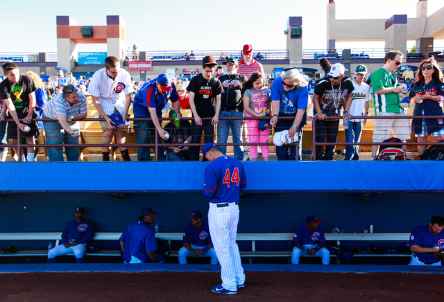 Anthony Rizzo of the Chicago Cubs signs autographs for fans before facing the Oakland Athletics in the Big League Weekend exhibition baseball game at Cashman Field in Las Vegas on Friday, March 13 ...
