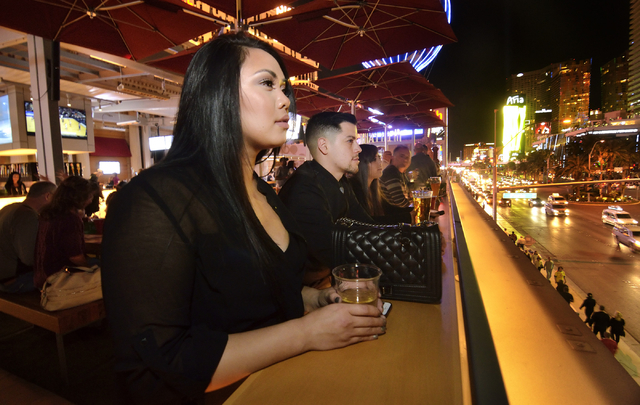 Kayla Leuluai, left, and Angel Quevedo are shown at the Beer Park in the Paris hotel-casino at 3655 Las Vegas Blvd. South in Las Vegas on Saturday, March 12, 2016. Bill Hughes/Las Vegas Review-Journal