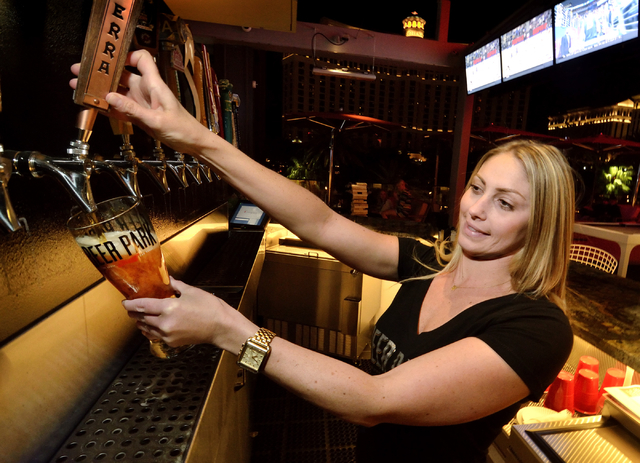 Bartender Laura Mitchell pulls a beer at the Beer Park in the Paris hotel-casino at 3655 Las Vegas Blvd. South in Las Vegas on Saturday, March 12, 2016. Bill Hughes/Las Vegas Review-Journal