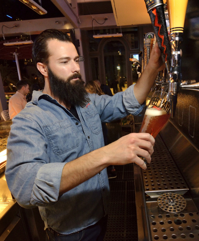 Bartender Joe Surdy pulls a beer at the Beer Park in the Paris hotel-casino at 3655 Las Vegas Blvd. South in Las Vegas on Saturday, March 12, 2016. Bill Hughes/Las Vegas Review-Journal