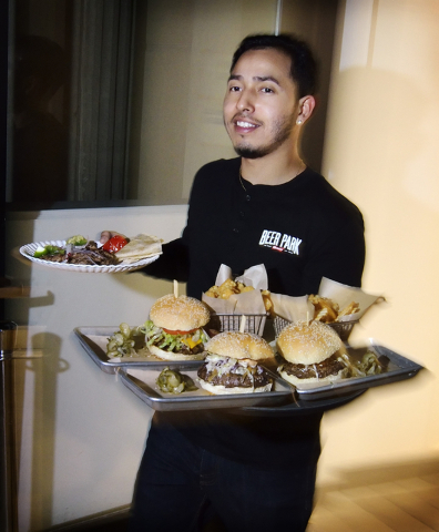 Server Martin Pedroza carries orders to a table at the Beer Park in the Paris hotel-casino at 3655 Las Vegas Blvd. South in Las Vegas on Saturday, March 12, 2016. Bill Hughes/Las Vegas Review-Journal