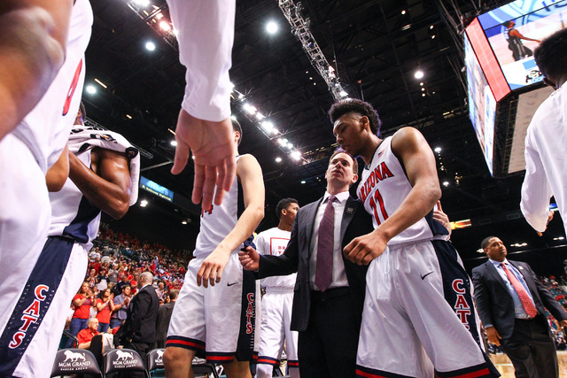 Arizona players, including Allonzo Trier (11), walk off the court at half time during a game against Colorado in the Pac-12 Conference basketball tournament  quarterfinals at the MGM Grand Garden  ...