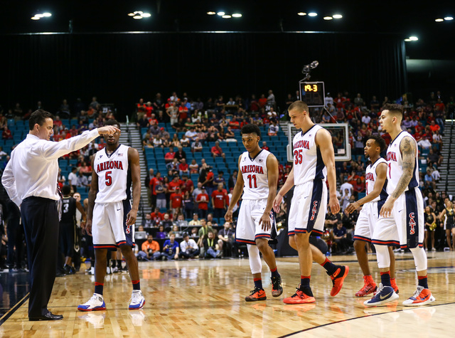 Arizona head coach Sean Miller directs his players as the take on Colorado during the Pac-12 Conference basketball tournament  quarterfinals at the MGM Grand Garden Arena in Las Vegas on Thursday, ...