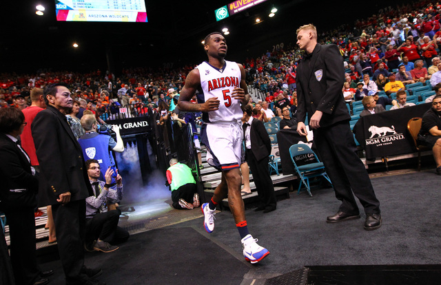 Arizona Wildcats guard Kadeem Allen (5) enters the arena before playing the Colorado Buffaloes during the Pac-12 Conference basketball tournament  quarterfinals at the MGM Grand Garden Arena in La ...