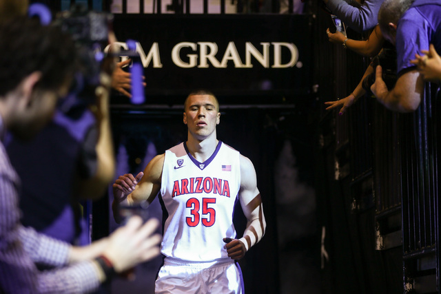 Arizona Wildcats center Kaleb Tarczewski (35) enters the arena before the start of their game against Colorado during the Pac-12 Conference basketball tournament  quarterfinals at the MGM Grand Ga ...
