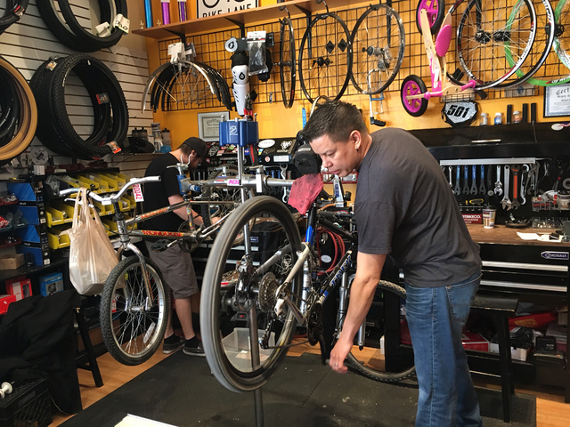 Chris Bernardi, left, and Mike Skoy work on bicycles inside The Vault Bicycle Shop, 7575 Norman Rockwell Lane, No. 120, Feb. 24. Skoy opened the store in May 2015 and sells a variety of bicycles i ...