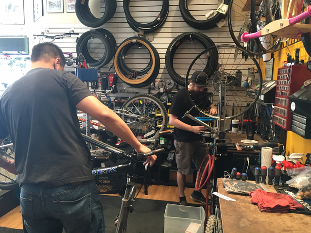 Mike Skoy, left, and Chris Bernardi work on bicycles inside The Vault Bicycle Shop, 7575 Norman Rockwell Lane, No. 120, Feb. 24. Sandy Lopez/View