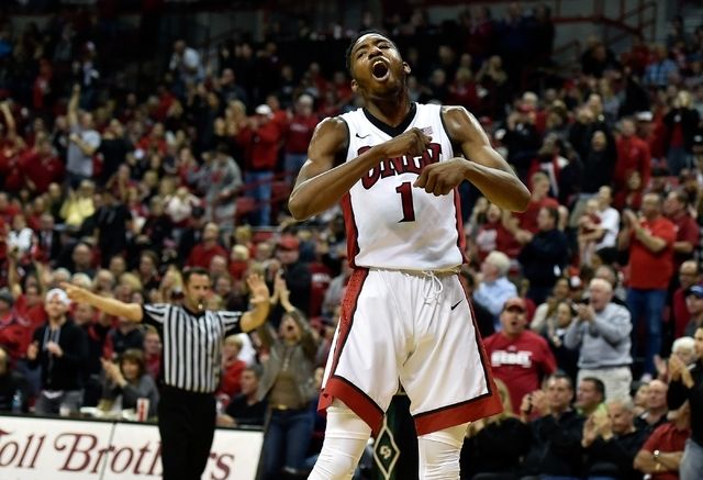 UNLV forward Derrick Jones Jr. (1) reacts after a basket against Cal Poly during an NCAA basketball game at the Thomas & Mack Center in Las Vegas Friday, Nov. 13, 2015. UNLV won, 74-72. David  ...