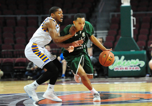CSU Bakersfield guard Dedrick Basile, left, fouls Chicago State guard Anthony Evans in the first half of their WAC Conference quarterfinal  basketball game at the Orleans Arena in Las Vegas Thursd ...