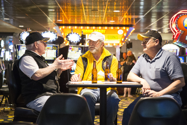 Bill Knowles, from left, Leon Breedlove, and Terry Nelson, discuss their NCAA tournament picks while watching a basketball game at The D sports book on Tuesday, March 15, 2016, in Las Vegas. Erik  ...