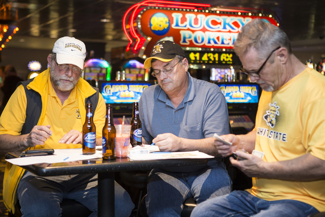 Leon Breedlove, from left, Terry Nelson, and Mark Herndon discuss their NCAA tournament picks while watching a basketball game at The D sports book on Tuesday, March 15, 2016, in Las Vegas. Erik V ...