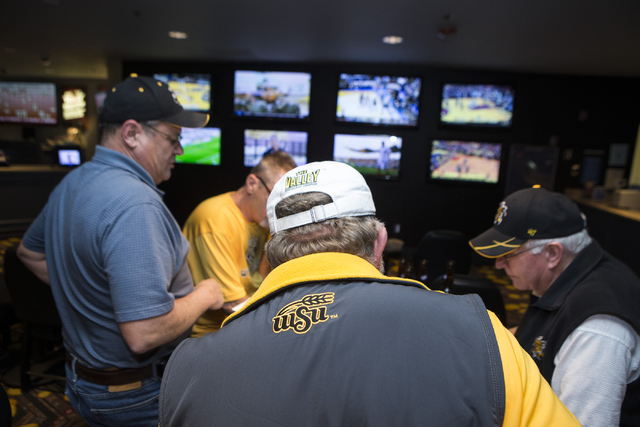 College basketball fans from Kansas discuss their NCAA tournament picks while watching a basketball game at The D sports book on Tuesday, March 15, 2016, in Las Vegas. Erik Verduzco/Las Vegas Revi ...