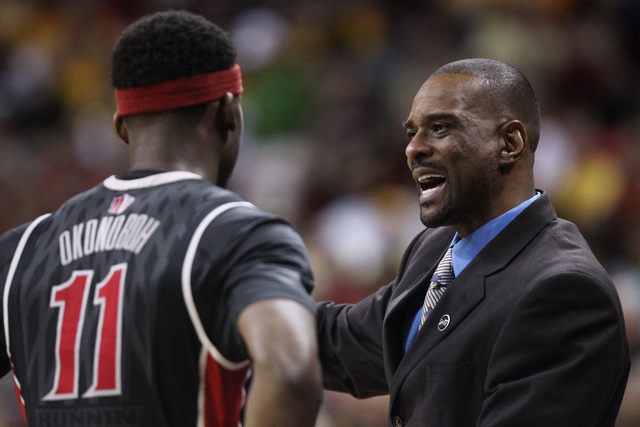 UNLV assistant coach Stacey Augmon talks with UNLV forward Goodluck Okonoboh during the second half of their Mountain West Conference tournament quarterfinal game against San Diego State Thursday, ...