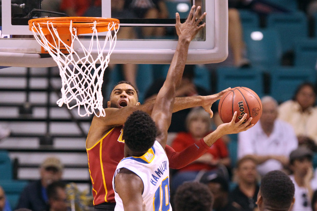 UCLA guard Isaac Hamilton defends a shot by USC guard Julian Jacobs during the first half of their Pac-12 Conference tournament game Thursday, March 12, 2015, at the MGM Grand Garden Arena. (Sam M ...
