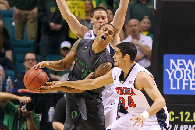 Arizona guard Elliott Pitts fouls Oregon guard Joseph Young during the second half of their Pac-12 Conference tournament championship game Saturday, March 14, 2015, at the MGM Grand Garden Arena.  ...