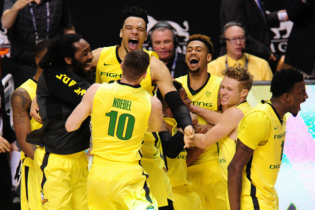 Oregon Ducks players celebrate their 88-57 win over Utah during the Pac 12 Conference tournament championship game at the MGM Grand Garden Arena in Las Vegas Saturday, March 11, 2016. (Josh Holmbe ...