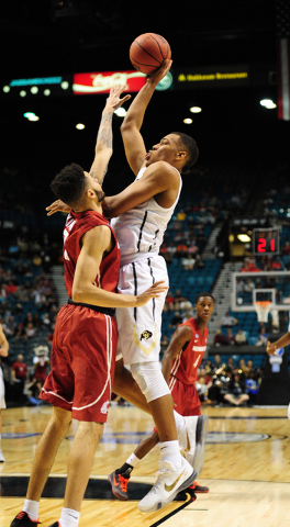 Colorado guard George King (24) goes up for a shot against Washington State forward Derrien King (0) in the second half of their Pac 12 Conference Tournament quarterfinal game at the MGM Grand Gar ...