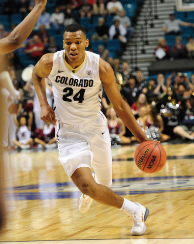 Colorado guard George King (24) drives the lane against Washington State in the second half of their Pac 12 Conference Tournament quarterfinal game at the MGM Grand Garden Arena in Las Vegas Wedne ...