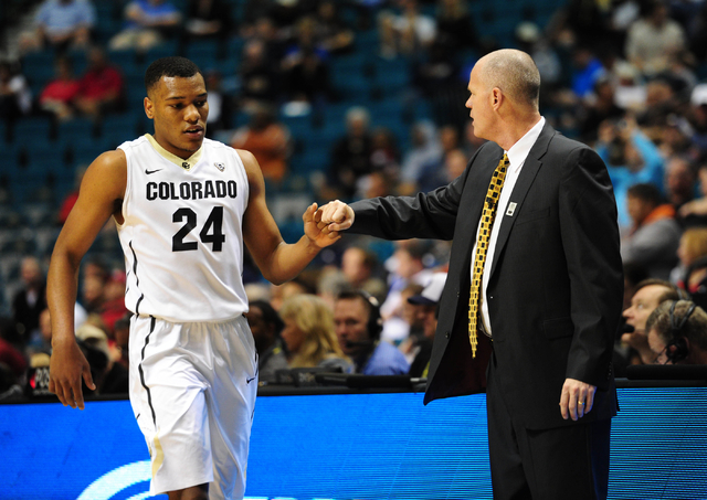 Colorado guard George King (24) high-fives head coach Tad Boyle after being taken out of their game against Washington State in the second half of their Pac 12 Conference Tournament quarterfinal g ...