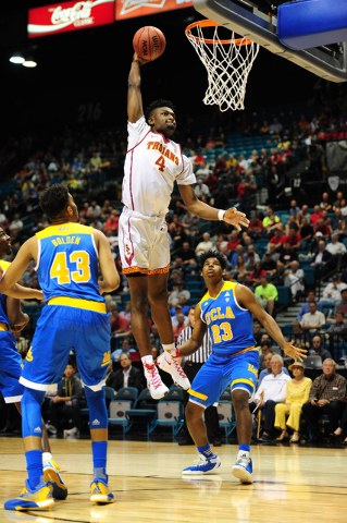 USC forward Chimezie Metu dunks against UCLA in the first half of their Pac 12 Conference Tournament quarterfinal game at the MGM Grand Garden Arena in Las Vegas Wednesday, March 9, 2016. USC defe ...