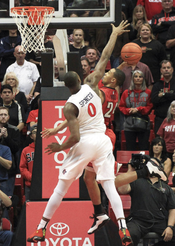 The Aztecs' Skylar Spencer tries to block UNLV's Jalen Poyser during the first half at the Viejas Arena in San Diego on Saturday. Hayne Palmour IV/San Diego Union-Tribune, LLC