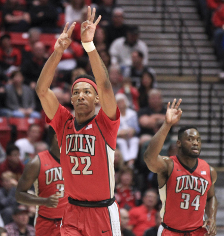 UNLV's Patrick McCaw holds his hands up after making a three point shot during the first half of UNLV's game against the Aztecs at the Viejas Arena in San Diego on Saturday. Hayne Palmour IV/San D ...