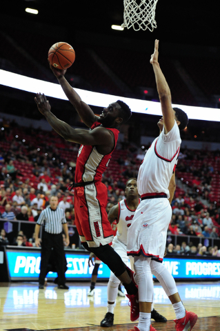 UNLV guard Ike Nwamu (34) goes up for a shot against Fresno State guard Cullen Russo in the first half of their Mountain West Conference semifinal basketball game at the Thomas & Mack Center i ...
