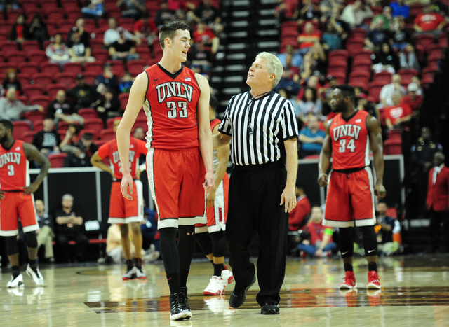 UNLV forward Stephen Zimmerman Jr. (33) talks with referee Eric Cury after he was assessed a technical foul against Fresno State in the first half of their Mountain West Conference semifinal baske ...