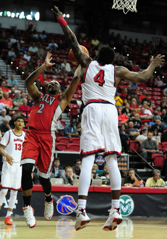 UNLV guard Jerome Seagears (2) fouls Fresno State forward Karacgi Edo (4) in the second half of their Mountain West Conference semifinal basketball game at the Thomas & Mack Center in Las Vega ...