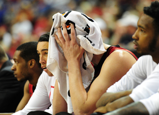 UNLV forward Stephen Zimmerman Jr. (33) wipes sweat from his face after he fouled out against Fresno State in the second half of their Mountain West Conference semifinal basketball game at the Tho ...