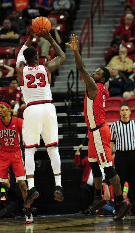 UNLV guard Jordan Cornish (3) attempts to block the shot of Fresno State guard Marvelle Harris (23) in the second half of their Mountain West Conference semifinal basketball game at the Thomas &am ...