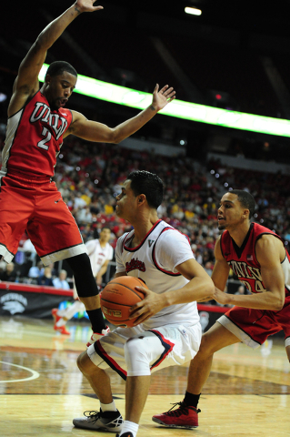 UNLV guards Jerome Seagears (2) and Jalen Poyser (24) defend Fresno State guard Cezar Guerrero (12) in the second half of their Mountain West Conference semifinal basketball game at the Thomas &am ...