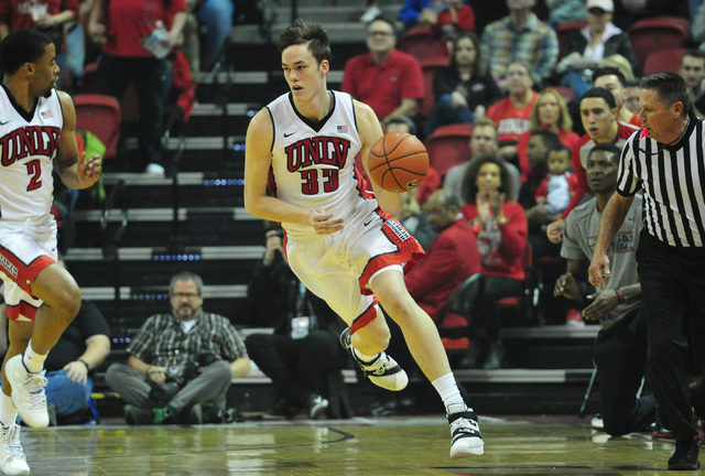 UNLV forward Stephen Zimmerman Jr. (33) dribbles the ball up-court against San Diego Sate in the first half of their NCAA college basketball game at the Thomas & Mack Center in Las Vegas Satur ...