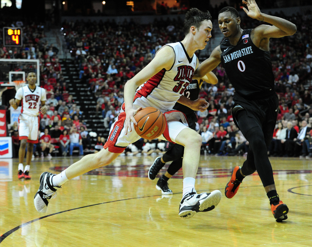 UNLV forward Stephen Zimmerman Jr. (33) drives to the basket against San Diego State forward Skylar Spencer (0) in the second half of their NCAA college basketball game at the Thomas & Mack Ce ...