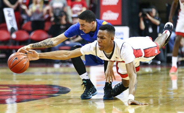 UNLV guard Patrick McCaw (22) and San Jose State guard Jalen James (21) dive for the ball during a basketball game at the Thomas & Mack Center in Las Vegas on Wednesday, Feb. 10, 2016. Chase S ...