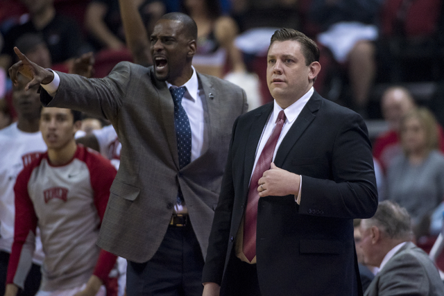 UNLV assistant coach Stacey Augmon, left, and UNLV head coach Todd Simon look on while playing the UNLV Rebels during the first half at the Thomas & Mack Center in Las Vegas on Saturday, Feb.  ...
