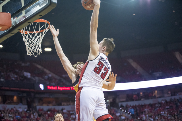 UNLV forward Stephen Zimmerman Jr. (33) dunks the ball over Wyoming center Jonathan Barnes (21) during the first half at the Thomas & Mack Center in Las Vegas on Saturday, Feb. 27, 2016. Joshu ...