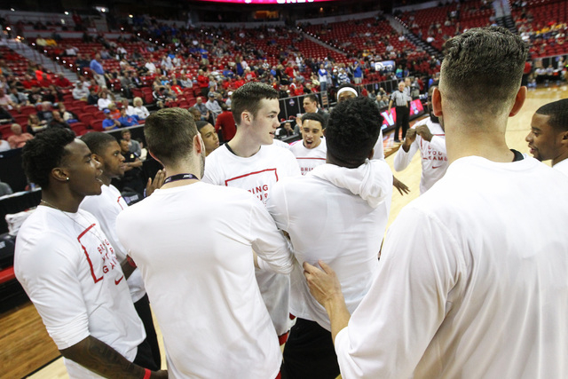 UNLV players huddle before their game against Air Force during the Mountain West Conference basketball tournament at the Thomas & Mack Center in Las Vegas on Wednesday, March 9, 2016. UNLV won ...