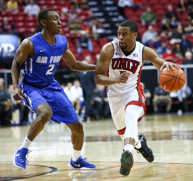 UNLV Rebels guard Jerome Seagears (2) drives against Air Force Falcons guard CJ Siples (2) during the Mountain West Conference basketball tournament at the Thomas & Mack Center in Las Vegas on ...