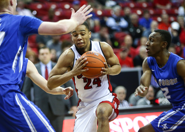 UNLV Rebels guard Jalen Poyser (24) drives past Air Force Falcons guard CJ Siples (2) during the Mountain West Conference basketball tournament at the Thomas & Mack Center in Las Vegas on Wedn ...