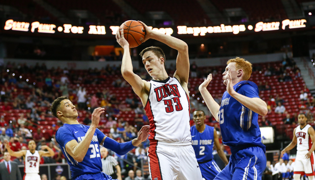 UNLV Rebels forward Stephen Zimmerman Jr. (33) gets control of a rebound between Air Force Falcons forward Hayden Graham (35) and Air Force Falcons center Frank Toohey (33) during the Mountain Wes ...