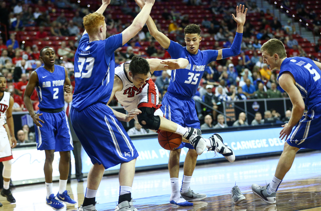 UNLV Rebels forward Stephen Zimmerman Jr. (33) crashes into Air Force Falcons center Frank Toohey (33) during the Mountain West Conference basketball tournament at the Thomas & Mack Center in  ...